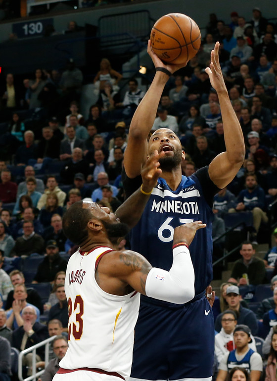 . Minnesota Timberwolves\' Taj Gibson, right, shoots over Cleveland Cavaliers\' LeBron James in the first half of an NBA basketball game Monday, Jan. 8, 2018, in Minneapolis. (AP Photo/Jim Mone)