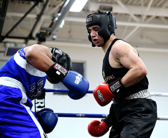 3/15/2019 Mike Orazzi | Staff West Points Elias Manning (red) and Uconns Rich Brito (blue) in a 185 bout during the National Collegiate Boxing Association National Qualifier held at the Bristol Boys & Girls Club in Bristol, Conn. Friday evening.