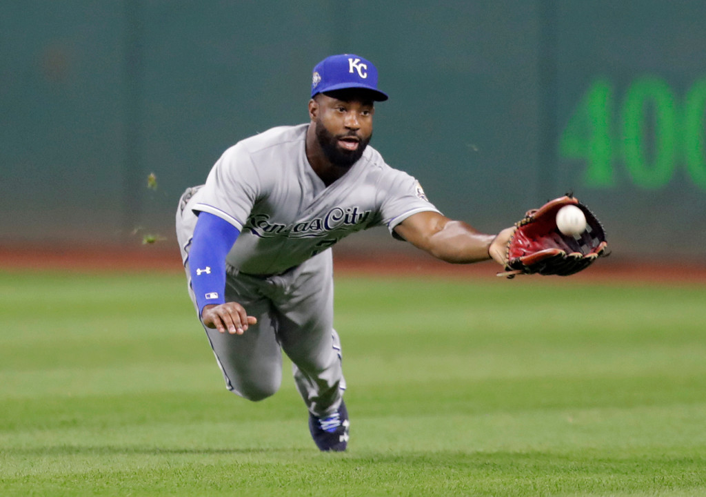 . Kansas City Royals\' Brian Goodwin dives for the ball hit by Cleveland Indians\' Brandon Guyer in the fourth inning of a baseball game, Tuesday, Sept. 4, 2018, in Cleveland. Guyer was out on the play. (AP Photo/Tony Dejak)
