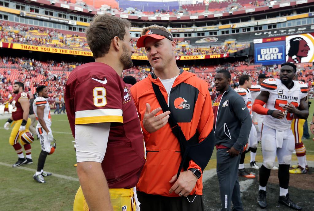 . Washington Redskins quarterback Kirk Cousins (8) talks with Cleveland Browns quarterback Josh McCown after an NFL football game Sunday, Oct. 2, 2016, in Landover, Md. The Redskins won 31-20. (AP Photo/Chuck Burton)