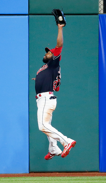 . Cleveland Indians\' Austin Jackson makes a leaping catch to get out Minnesota Twins\' Joe Mauer during the ninth inning in a baseball game, Wednesday, Sept. 27, 2017, in Cleveland. The Indians won 4-2. (AP Photo/Ron Schwane)