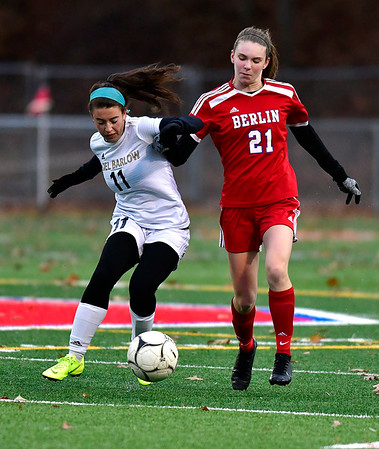 11/12/2019 MIke Orazzi | StaffrJoel Barlow High School's Rachel Horowitz (11) and Berlin High School's Jenna Wenzel(21) during the Class L First Round Girls Soccer Tournament with Joel Barlow in Sage Park in Berlin.