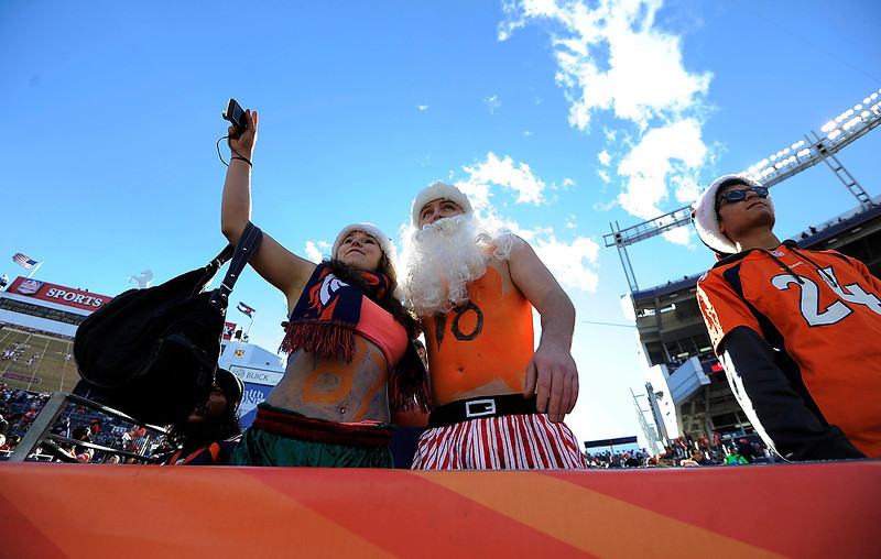 . Jennifer Foster and Austin Roach both from Albuquerque, NM wait for the game to start against the Cleveland Browns at Sports Authority Field on Sunday December 23, 2012. John Leyba, The Denver Post