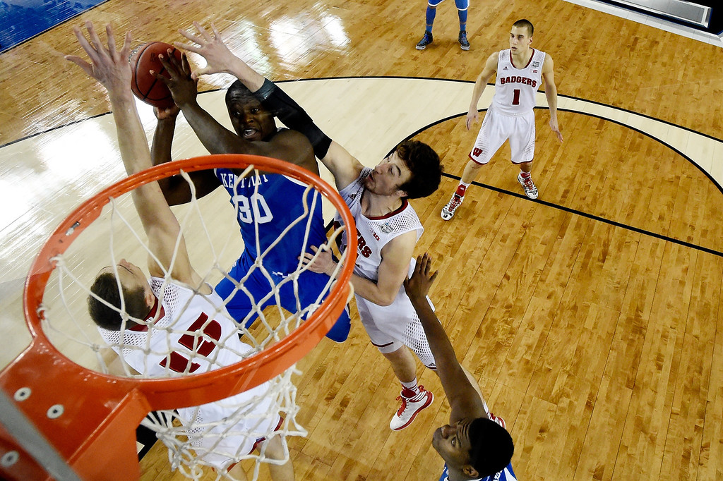 . ARLINGTON, TX - APRIL 05: Julius Randle #30 of the Kentucky Wildcats goes to the basket as Frank Kaminsky #44 of the Wisconsin Badgers defends during the NCAA Men\'s Final Four Semifinal at AT&T Stadium on April 5, 2014 in Arlington, Texas. (Photo by Chris Steppig-Pool/Getty Images)