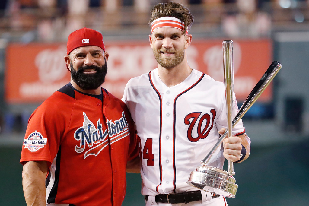 . Washington Nationals Bryce Harper stands with his father Ron Harper after Bryce won the Major League Baseball Home Run Derby, Monday, July 16, 2018 in Washington. The 89th MLB baseball All-Star Game will be played Tuesday. (AP Photo/Alex Brandon)