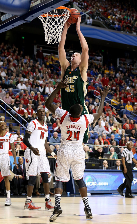 . LEXINGTON, KY - MARCH 23: Colton Iverson #45 of the Colorado State Rams goes up for a dunk and is called for an offensive foul against Montrezl Harrell #24 of the Louisville Cardinals in the first half during the third round of the 2013 NCAA Men\'s Basketball Tournament at Rupp Arena on March 23, 2013 in Lexington, Kentucky.  (Photo by Andy Lyons/Getty Images)