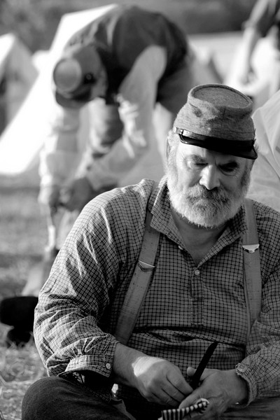 Reenactor Sergeant Mike Scott cooks a meal at Ft. Moultrie in Sullivan's Island, South Carolina on Monday, April 11, 2011. ..The 150th Anniversary of the Firing on Ft. Sumter was commemorated with lectures, performances, demonstrations, and a living history throughout the area on James Island, Charleston, Mt. Pleasant, and Sullivan's Island during the week from April 8-14, 2011. Photo Copyright 2011 Jason Barnette