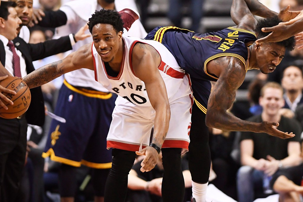 . Toronto Raptors guard DeMar DeRozan (10) and Cleveland Cavaliers guard Iman Shumpert (4) become entangled during the second half of Game 3 of an NBA basketball second-round playoff series in Toronto on Friday, May 5, 2017. (Frank Gunn/The Canadian Press via AP)