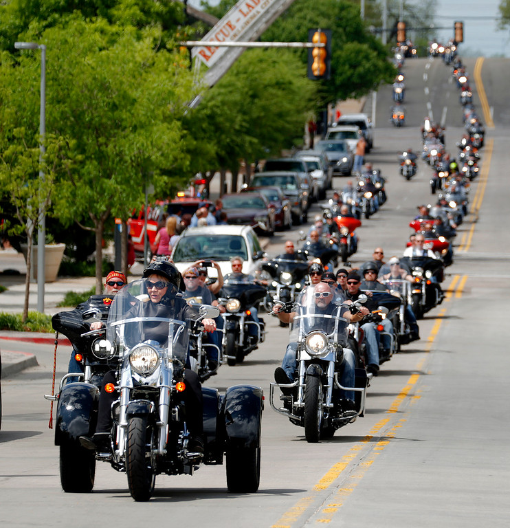 . Gov. Mary Fallin leads a line of motorcycles toward the Oklahoma City National Memorial & Museum during the eighth annual Ride to Remember memorial motorcycle run across Oklahoma City, Saturday, April 18, 2015. Organizers said 1595 motorcycles participated in the benefit ride that included a stop at the Oklahoma City National Memorial to place a wreath a day before the 20th anniversary of the Oklahoma City bombing. (Bryan Terry/The Oklahoman via AP)