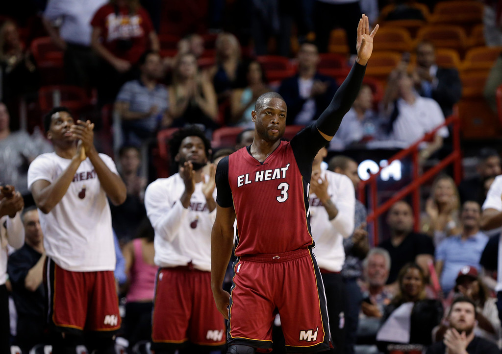 . Miami Heat guard Dwyane Wade (3) waves to the crowd after being acknowledged for scoring 20,000 career points during the second half of an NBA basketball game against the Cleveland Cavaliers, Saturday, March 19, 2016, in Miami. (AP Photo/Lynne Sladky)