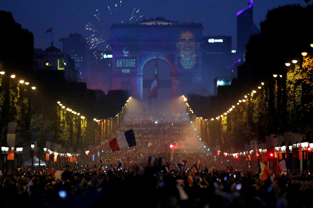 . The name of French soccer striker Antoine Griezmann is projected onto the Arc de Triomphe after France won the soccer World Cup final match between France and Croatia, Sunday, July 15, 2018 in Paris. France won its second World Cup title by beating Croatia 4-2 . (AP Photo/Francois Mori)