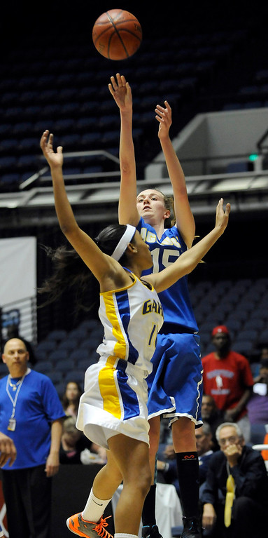 . Agoura #15 Kim Jacobs shoots over Gahr defender. Agoura defeated Gahr 60-39 in the CIF-SS Division III-AAA Girls Basketball Championship at the Anaheim Convention Center in Anaheim, CA 2/23/2013(John McCoy/Staff Photographer)