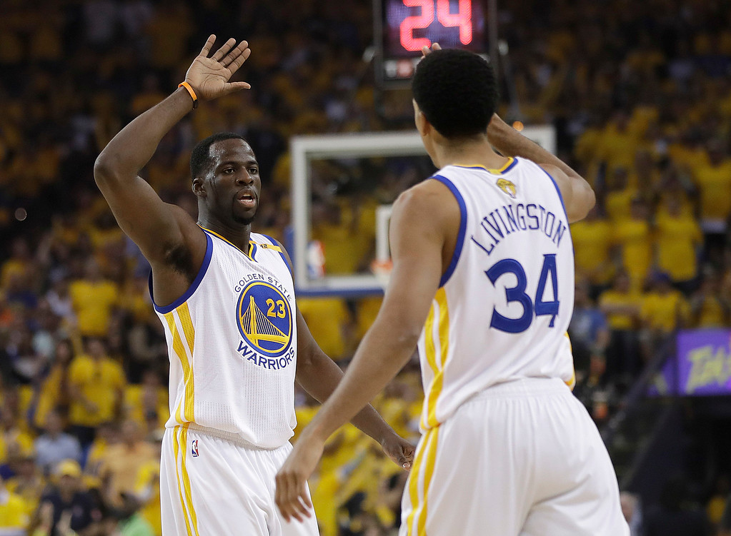 . Golden State Warriors forward Draymond Green (23) reacts with guard Shaun Livingston (34) during the first half of Game 5 of basketball\'s NBA Finals against the Cleveland Cavaliers in Oakland, Calif., Monday, June 12, 2017. (AP Photo/Marcio Jose Sanchez)
