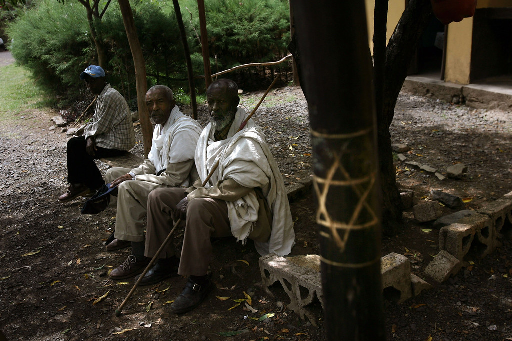 . GONDAR, ETHIOPIA - MAY 1: Ethiopian Jewish men in the compound of the Jewish Joint Distribution Committee on May 1, 2007 in Gondar in northern Ethiopia. Some 2,500 Ethiopians of Jewish origin from this province remain in the East African country as Israel slowly brings them over, a few dozen at a time, on commercial flights. Since 1984, more than 73,000 Ethiopian Jews have been settled in Israel. (Photo by Uriel Sinai/Getty Images)
