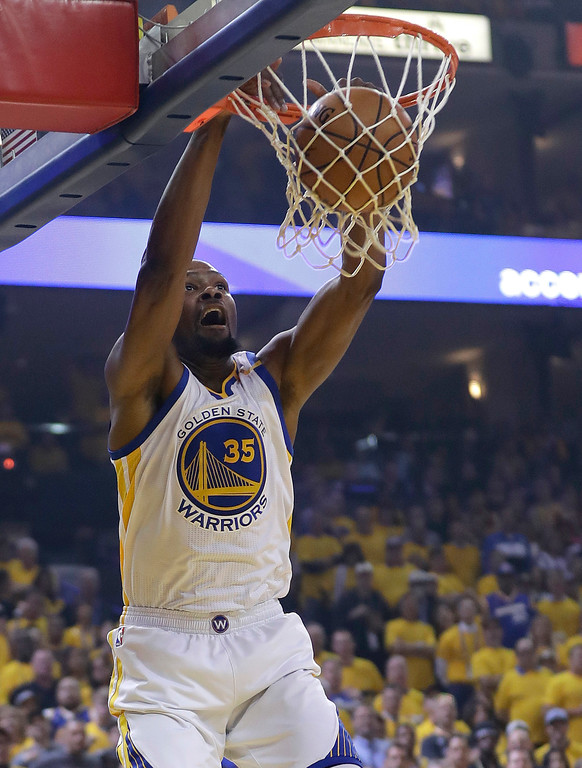 . Golden State Warriors forward Kevin Durant (35) dunks against the Cleveland Cavaliers during the first half of Game 1 of basketball\'s NBA Finals in Oakland, Calif., Thursday, June 1, 2017. (AP Photo/Marcio Jose Sanchez)
