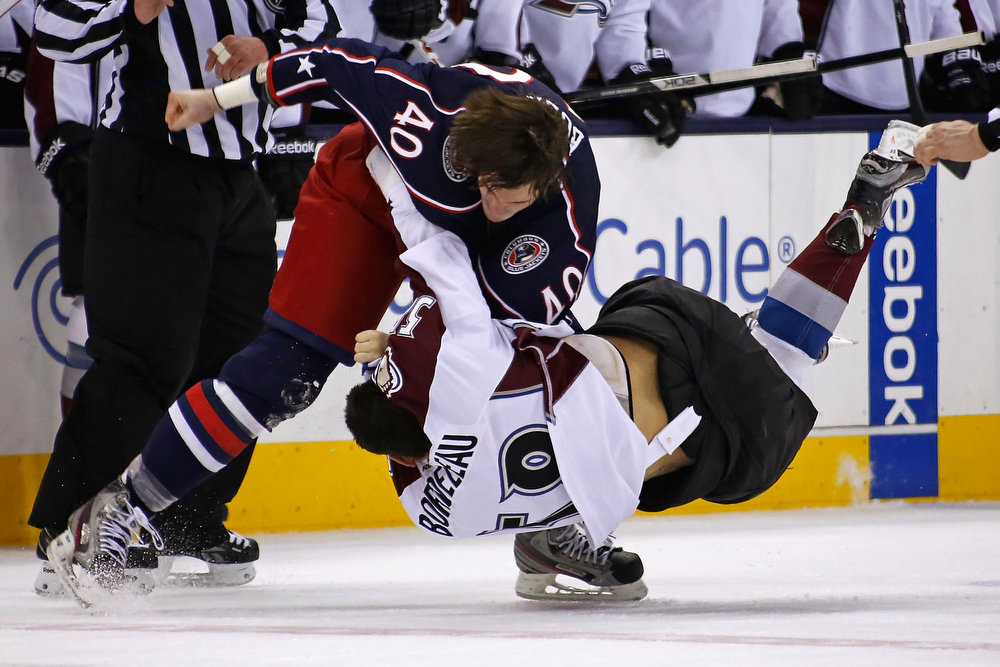. Jared Boll #40 of the Columbus Blue Jackets throws a punch as Patrick Bordeleau #58 of the Colorado Avalanche falls to the ice during a fight in the second period on March 3, 2013 at Nationwide Arena in Columbus, Ohio. (Photo by Kirk Irwin/Getty Images)