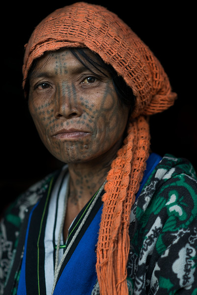 Portarit of a woman from the Muun tribe. The tattoos on her face shows the tribe she is from.  Chin State, Myanmar, 2017.