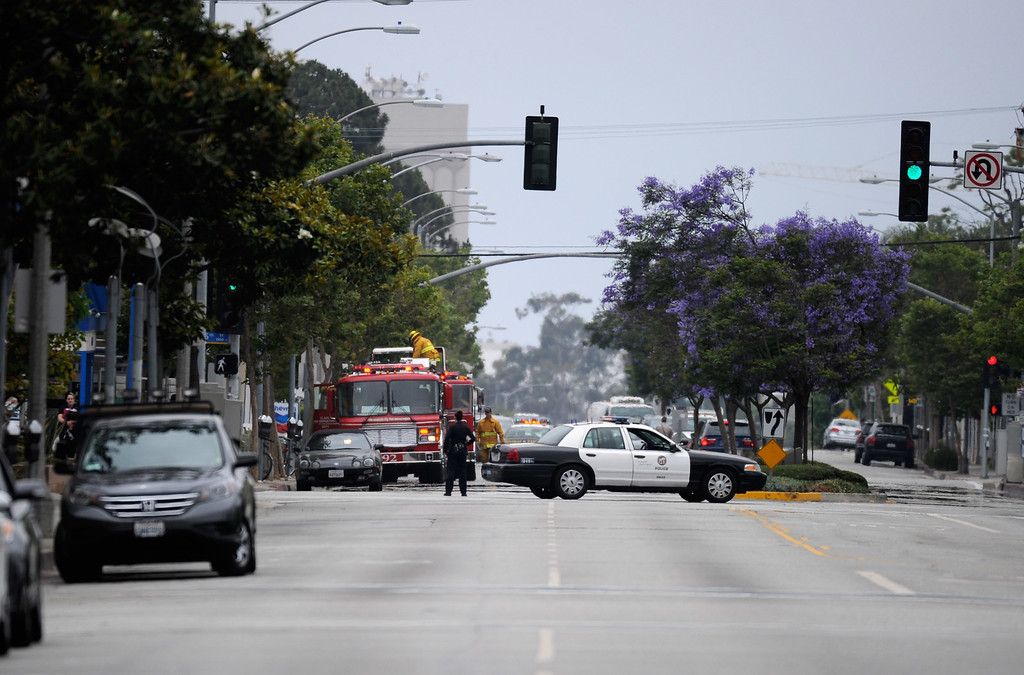 . SANTA MONICA, CA - JUNE 07:  Fire trucks and police vehicles arrive on scene after multiple shootings were reported on the campus of Santa Monica College June 7, 2013 in Santa Monica, California.  According to reports, at least one person has died, four people hospitalized, and a suspect was taken into custody. (Photo by Kevork Djansezian/Getty Images)