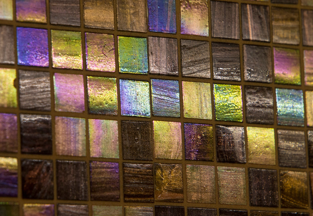 . Close-up photo of the iridescent mosaic backsplash in the kitchen of Madhu Charan, in San Mateo, Calif., on Tuesday, Jan. 29, 2013. (John Green/Staff)