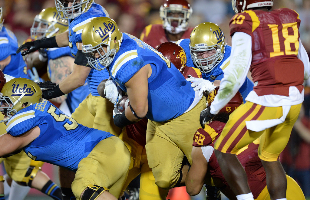 . UCLA�s Eddie Vanderdoes #47 powers in for a touchdown during their game against USC at the Los Angeles Memorial Coliseum Saturday, November 30, 2013.  (Photo by Hans Gutknecht/Los Angeles Daily News)