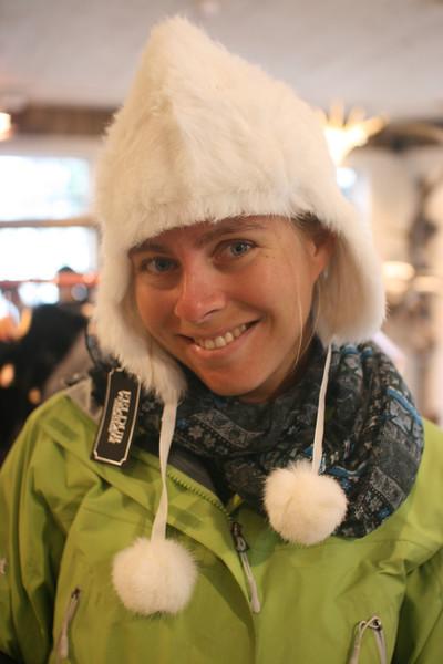Kjirsten models happy smiling headware.