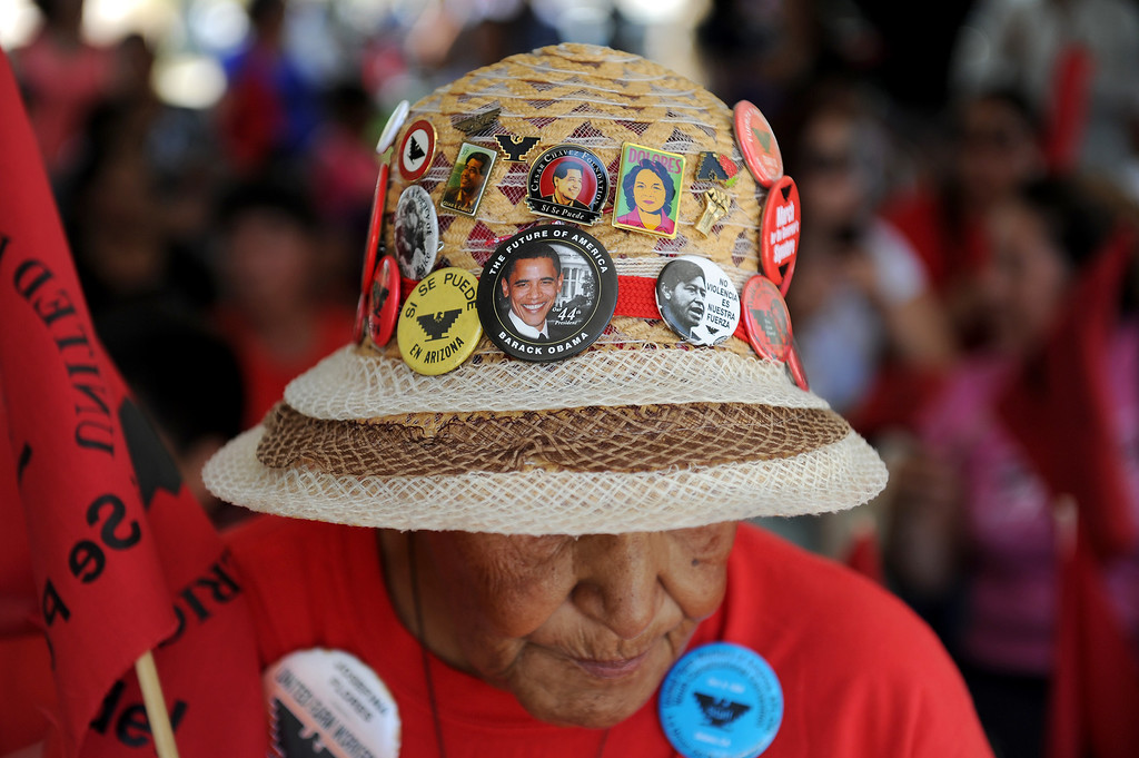 ". Josefina Flores, of Delano, wears political buttons to the ""Caravan for Citizenship\"" rally at Yokuts Park in Bakersfield, Wednesday, August 14, 2013. (Michael Owen Baker/L.A. Daily News)"