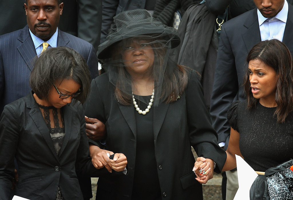 . CHICAGO, IL - APRIL 08:  Chaz Ebert (C), the wife of film critic Roger Ebert, leaves Holy Name Cathedral following a funeral service for her husband April 8, 2013 in Chicago, Illinois. Ebert died April 4, at the age of 70, after a long battle with cancer.  (Photo by Scott Olson/Getty Images)