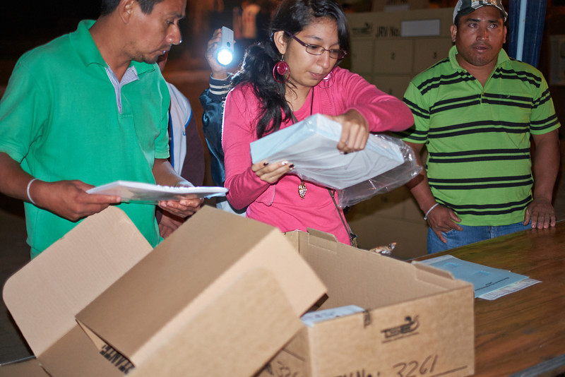 Election day in Santa Ana: <br /> Election officials inspect the contents of their box; here, the package of 500 ballots.