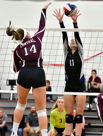 10/30/2019 Mike Orazzi | StaffrBristol Central's Kathryn Ross (14) and Bristol Eastern's Ryley Plourde (11) during Wednesday night's volleyball match at Bristol Central. r