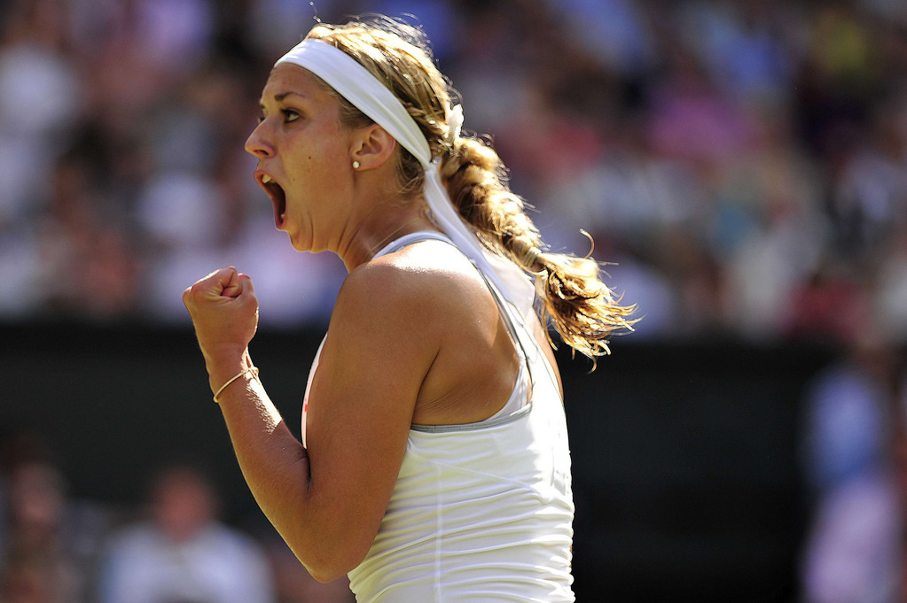. Germany\'s Sabine Lisicki reacts to winning a game in the third set during her women\'s singles semi-final match against Poland\'s Agnieszka Radwanska on day ten of the 2013 Wimbledon Championships tennis tournament at the All England Club in Wimbledon, southwest London, on July 4, 2013. GLYN KIRK/AFP/Getty Images