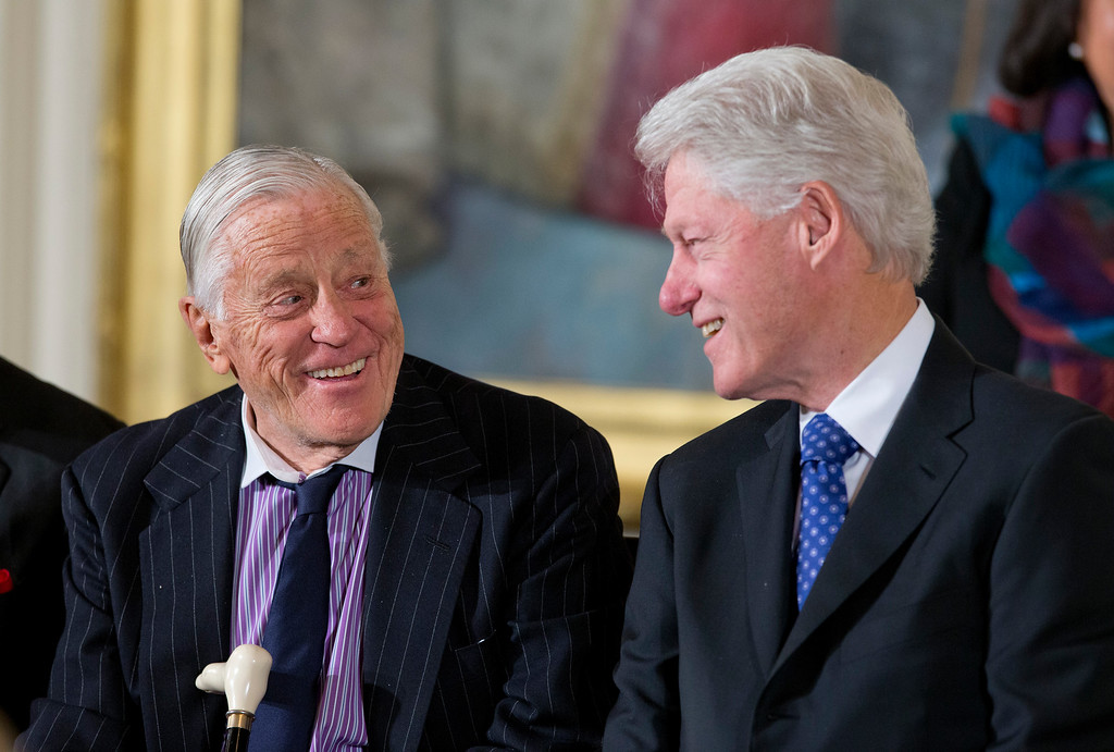 . Former Washington Post executive editor Ben Bradlee, left, talks with former President Bill Clinton in the East Room of the White House in Washington, Wednesday, Nov. 20, 2013, during a ceremony where President Barack Obama presented them, and others, with the Presidential Medal of Freedom. (AP Photo/ Evan Vucci)