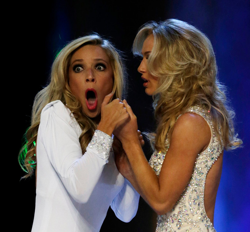 . Miss New York Kira Kazantsev, left, gasps after she was named Miss America 2015 as she holds hands with Miss Virginia Courtney Paige Garrett during the Miss America 2015 pageant, Sunday, Sept. 14, 2014, in Atlantic City, N.J. (AP Photo/Julio Cortez)