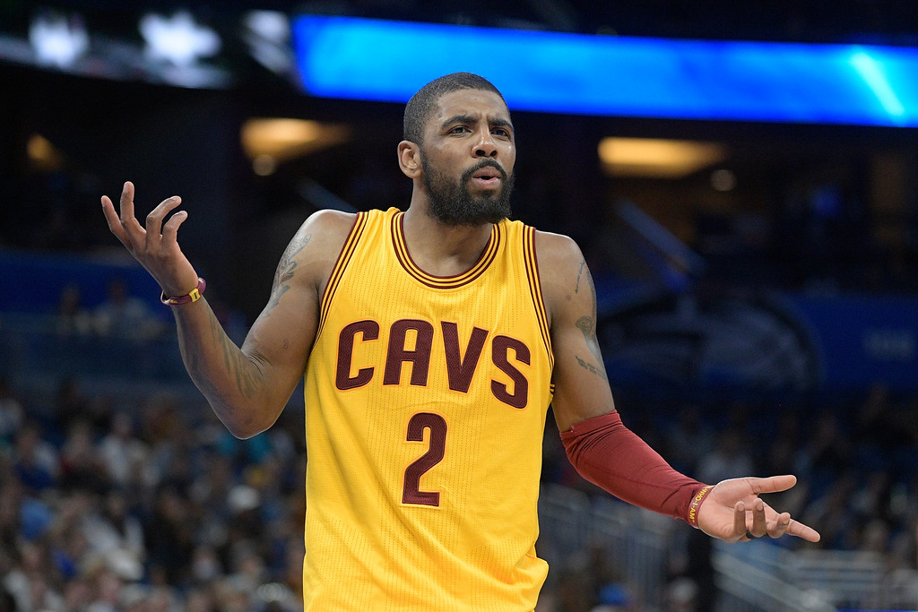 . Cleveland Cavaliers guard Kyrie Irving (2) reacts after a play during the second half of an NBA basketball game against the Orlando Magic in Orlando, Fla., Saturday, March 11, 2017. The Cavaliers won 116-104. (AP Photo/Phelan M. Ebenhack)