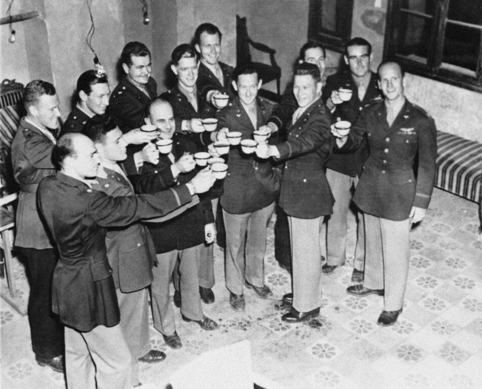 . FILE - In this July 14, 1943 file photo, Maj. Gen. James Doolittle, (third from left, front row) who led the air raid on Japan, April 18, 1942, and some of the men who flew with him drink a champagne toast from coffee cups during a reunion in North Africa on the first anniversary of the flight.  Flyers are left to right front row: Maj. William Bower, Ravenna, OH; Maj. Travis Hoover, Arlington, Calif.; Maj. Gen. Doolittle Lt. Col. Harvey Hinman, San Francisco, (not one of raiders); Capt. Neston C. Daniel, Plaquemine, LA., Back row left to right: Capt. Howard A. Sessler of Arlington, Mass., who brought the picture to this country; Capt. William R. Pound, Jr., Kent Homes VA.; Maj. Rodney R. Wilder, Taylor, Tex.; Capt. James M. Arker, Livingston, Tex., Maj. Charles R. Greening, Tacoma, Wash., Maj. Joseph Klein, Paradise, Tex.; Capt. Griffith P. William, San. Diego, Calif., and Capt. Thomas C. Griffin, Chicago, Ill. (AP Photo)
