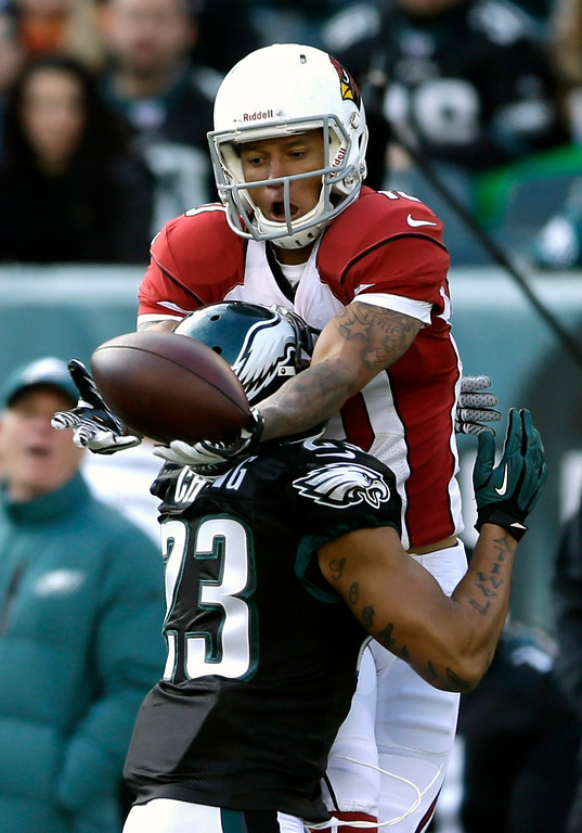 . Arizona Cardinals\' Brittan Golden (10) unable to catch a pass as Philadelphia Eagles\' Patrick Chung (23) defends during the first half of an NFL football game, Sunday, Dec. 1, 2013, in Philadelphia. (AP Photo/Matt Rourke)