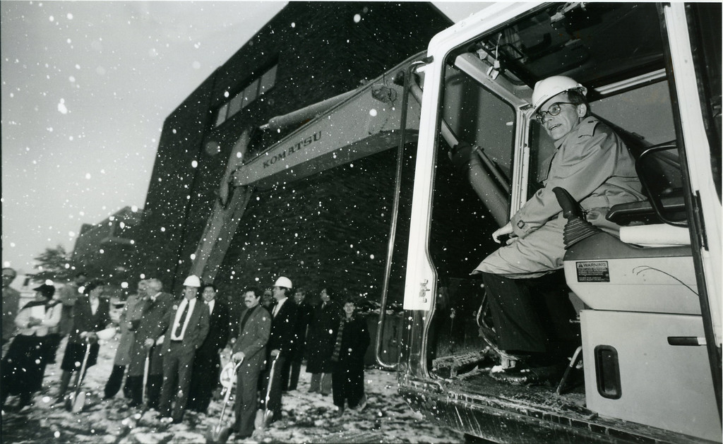 . Lakeland Community College President Dr. Ralph Doty, right, climbs into the cab of a back hoe, although he wasn\'t permitted to operate it, during groundbreaking ceremonies for the college\'s Health Technologies building on Nov. 29, 1993. (News-Herald file)