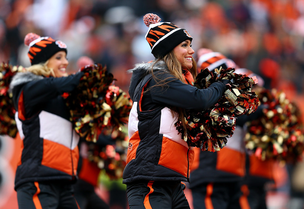. Cincinnati Bengals cheerleaders perform during a Wild Card Playoff game against the San Diego Chargers at Paul Brown Stadium on January 5, 2014 in Cincinnati, Ohio.  (Photo by Andy Lyons/Getty Images)