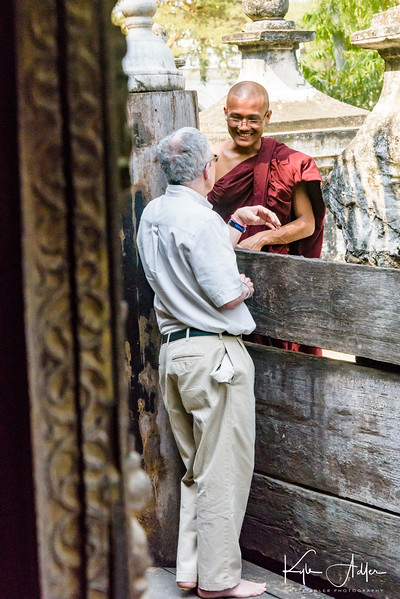 Jeff chats with a monk at Shwenandaw Kyaung Monastery.