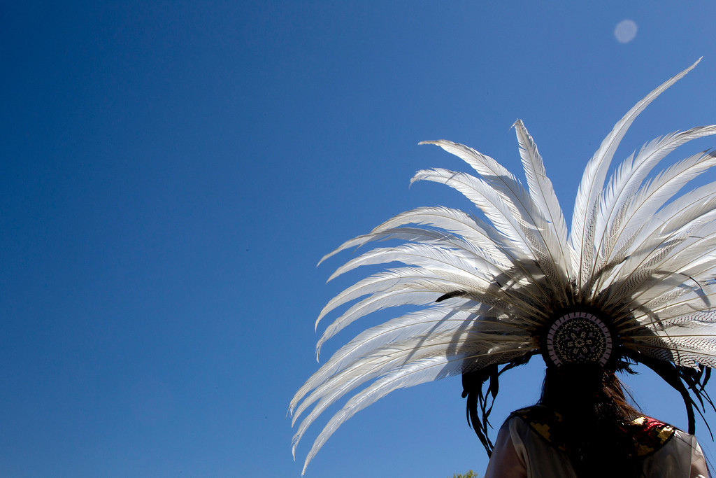 . May 1,  2013 - Salem, OR - A Native American dancer performs for a crowd at the start of a May Day rally, a traditional day of celebrating working people, on the steps of the State Capitol in Salem, Ore. on Wednesday,  May 1,  2013.  (AP Photo/The Oregonian, Beth Nakamura)