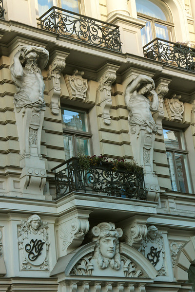 Notice the muscular men balancing stacks of Corinthian columns on their shouders Apartment building with shops (1901) located at Elizabetes iela 33 -Riga, Latvia