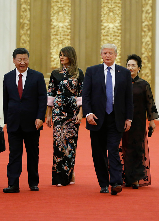 . U.S. President Donald Trump and first lady Melania Trump arrive for the state dinner with China\'s President Xi Jinping and China\'s first lady Peng Liyuan at the Great Hall of the People in Beijing, China, Thursday, Nov. 9, 2017. (Thomas Peter/Pool Photo via AP)