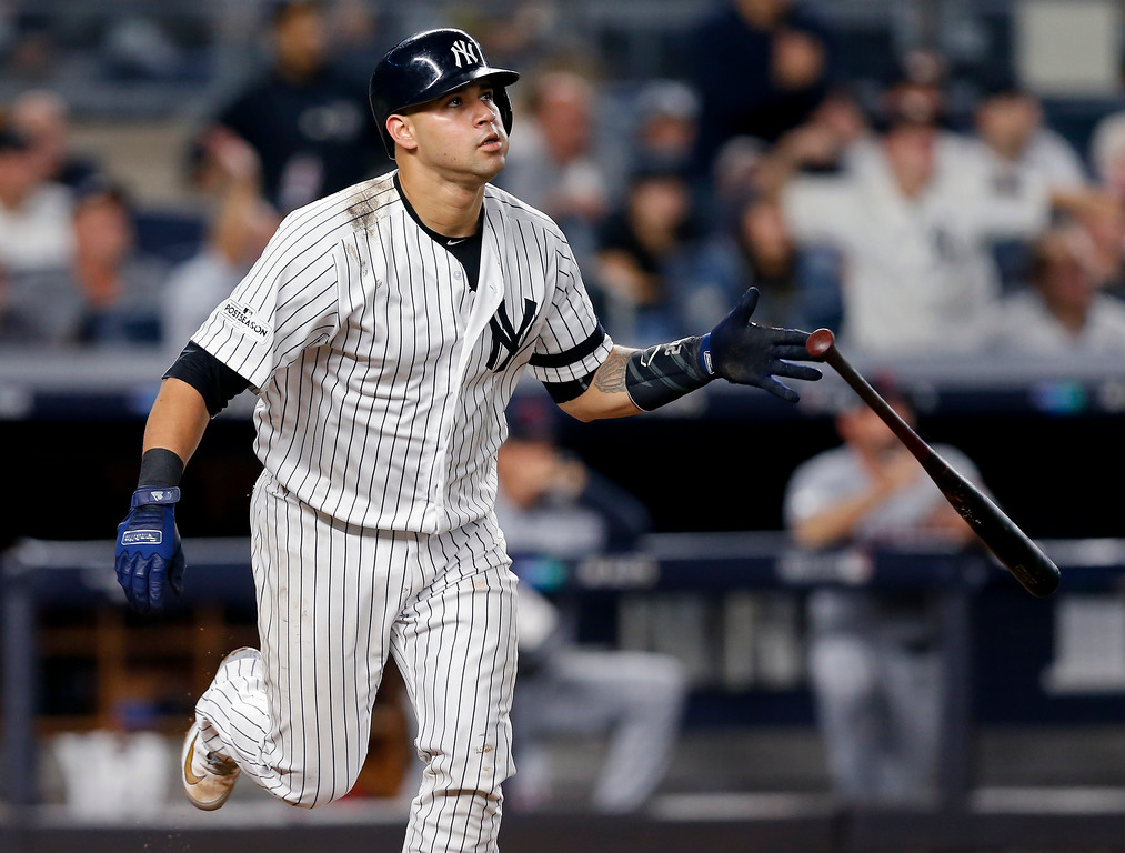 . New York Yankees\' Gary Sanchez (24) drops his bat after connecting for a solo home run against the Cleveland Indians during the sixth inning in Game 4 of baseball\'s American League Division Series, Monday, Oct. 9, 2017, in New York. (AP Photo/Kathy Willens)