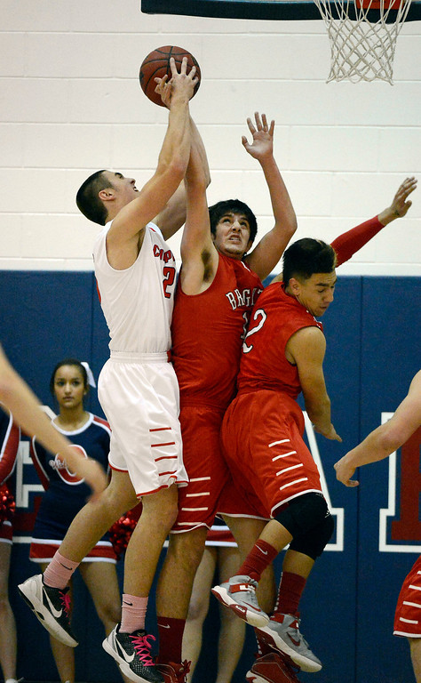 . Chaparral Wil Keyser (25) goes up for a rebound over Brighton Jaren Snyder (10) and Nathan Morales (2) during the second quarter February 27, 2013. (Photo By John Leyba/The Denver Post)
