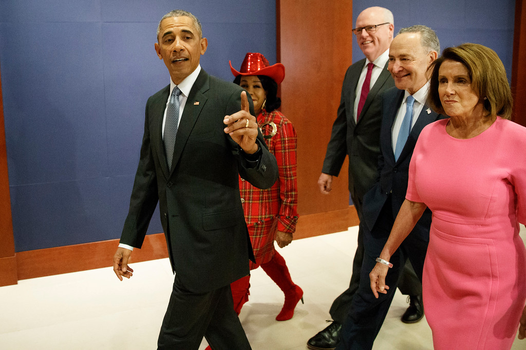. President Barack Obama, joined by, from second from left, Rep. Frederica Wilson, D-Fla., Rep. Joseph Crowley, D-N.Y., Senate Minority Leader Charles Schumer of N.Y., and House Minority Leader Nancy Pelosi of Calif. arrives on Capitol Hill in Washington, Wednesday, Jan. 4, 2017, to meet with members of Congress to discuss his signature healthcare law. (AP Photo/Evan Vucci)