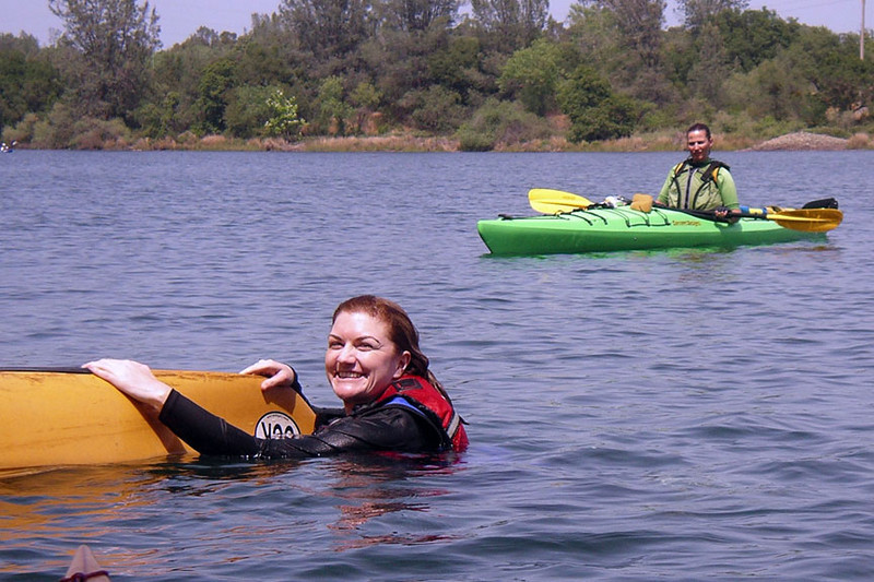 Amy at the stern, waiting for the T rescue to begin.  Great smile!  Karen observes.