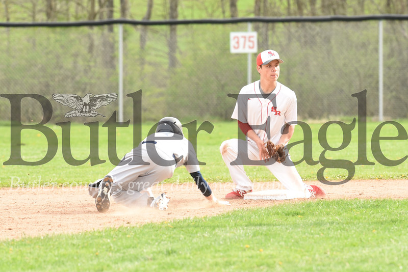Slippery Rock second baseman Walker Allison attempts to catch an Oil City base runner off base. Seb Foltz/Butler Eagle