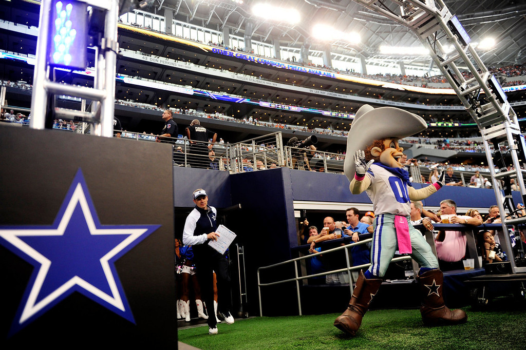 . Dallas Cowboys mascot Rowdy leads the team out onto the field before the first half of action at AT&T Stadium. The Denver Broncos visit the Dallas Cowboys. (Photo by AAron Ontiveroz/The Denver Post)