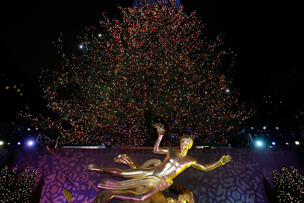 . The Rockefeller Center Christmas tree is lit in New York, Wednesday, Nov. 29, 2006.  This is the 74th annual lighting of the tree, which stands 88 feet tall and is decorated with 30,000 lights.  (AP Photo/Seth Wenig)