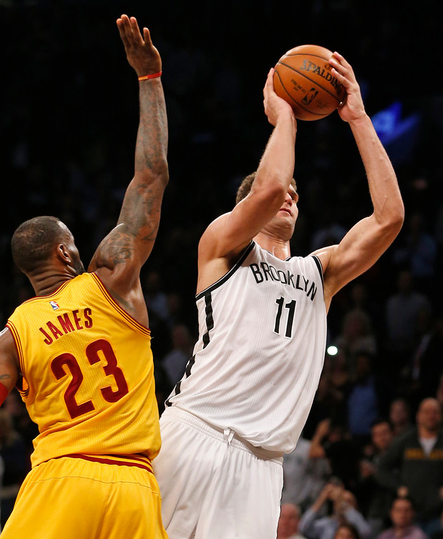 . Cleveland Cavaliers forward LeBron James (23) defends Brooklyn Nets center Brook Lopez (11) in the second half of an NBA basketball game, Thursday, March 24, 2016, in New York. Lopez had 22 points as the Nets beat the Cavaliers 104-95. (AP Photo/Kathy Willens)