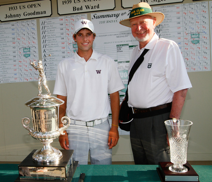 Stroke-play medalist Chris Williams, 20, of Moscow, Idaho, with WGA Chairman Roger Mohr after receiving award as the low medalist with a score of 16-under par.